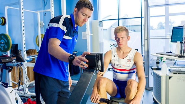 Exercise physiologist Peter Bonner working with rower Gavin Horsburgh